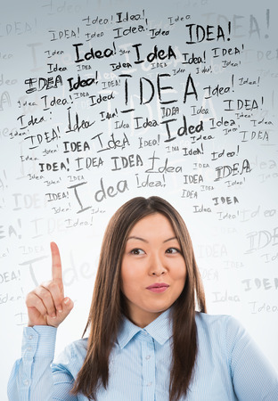 Idea concept. Young business woman with idea signs in front photo