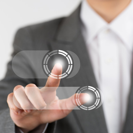 multitouch: Business woman pushing virtual button on touch screen