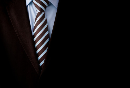 lawyers: Black business suit with a tie and copyspace background