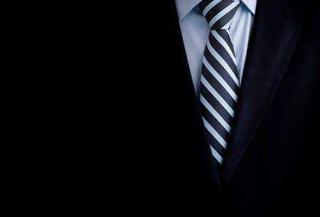 legal: Black business suit with a tie and copyspace background