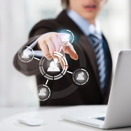 function key: Technology concept. Businessman and virtual interface with web and social media icons
