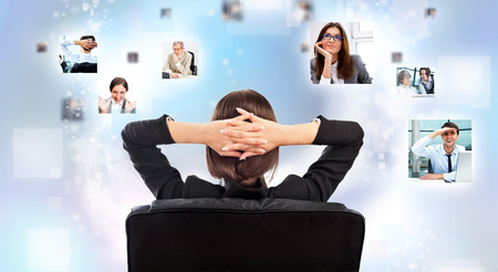 Portrait of businesswoman from behind communicating with her team across the world. International communications concept