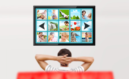 watching tv: Man watching tv. Photo from behind. Editable copyspace at the screen