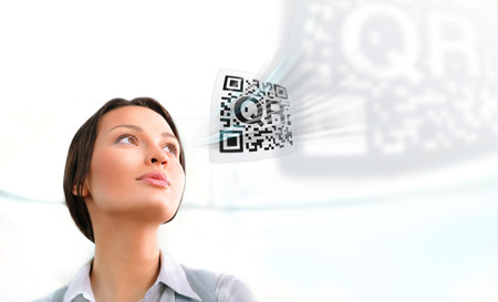 Business woman working with virtual qr code