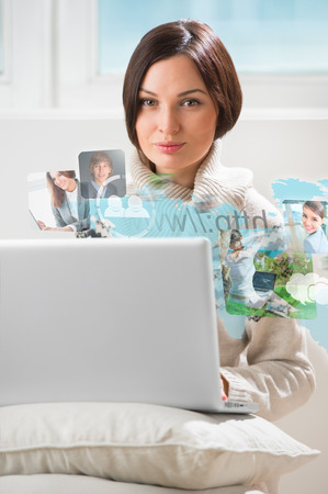 Pretty woman surfing on web with modern laptop photo