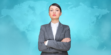Business woman looking at camera with map on background  photo