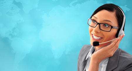 Telemarketing headset woman from call center smiling happy talking in hands free headset device. Business woman in suit in front of world map background. photo