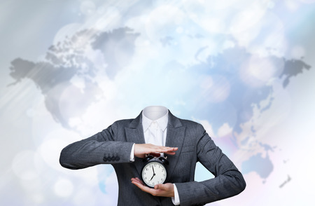 no problems: Business woman without head holding alarm clock. Freelance work concept - no authority, no staff, no problems Stock Photo