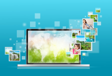 background pictures: Open laptop at blue background. Pictures are flying out of the screen Stock Photo