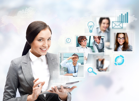 transmitting device: Portrait of businesswoman holding her tablet computer and communicating with her team across the world. International communications concept