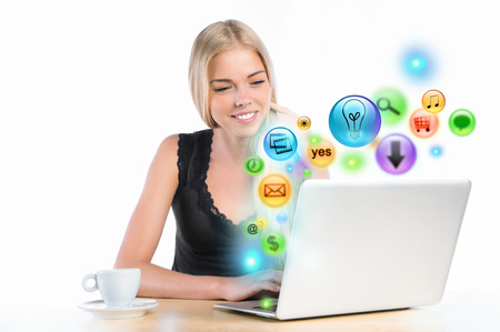 icons site search: Young woman using her laptop for multimedia and site surfing. Different icons appearing from the screen Stock Photo