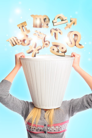 lampshade: Young woman wearing lampshade and zodiac symbols falling inside. Young female head is busy with horoscope predictions concept. Typical girls leisure
