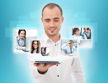 business partner: Adult businessman using his tablet computer to communicate his team. Virtual meeting technology for global business concept. Stock Photo