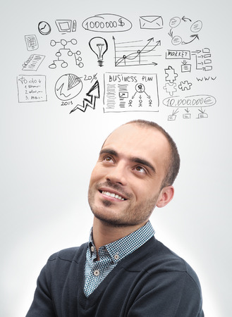 Young business man looking up and planning  Graphic sketch style thoughts overhead