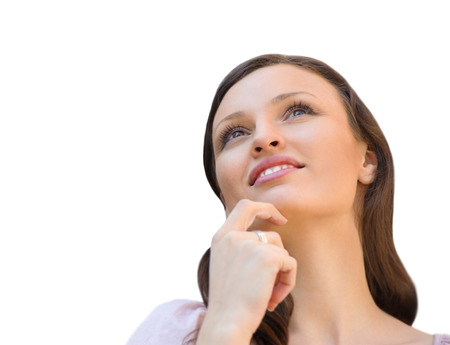 Beautiful young woman daydreaming over white background with finger on chin Stock Photo