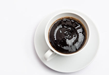 top animated: White cup of hot bracing coffee. Beverage is shaking and full of energy