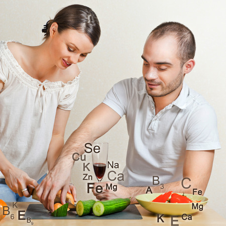 helthcare: Young lovely couple cooking a balanced diet