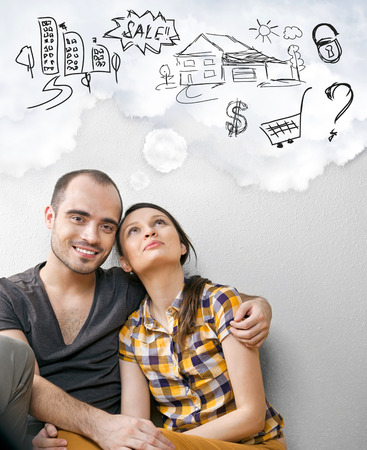 Closeup portrait of adult couple sitting on floor at their apartment and planning renovation of their new apartment while resting during housework photo