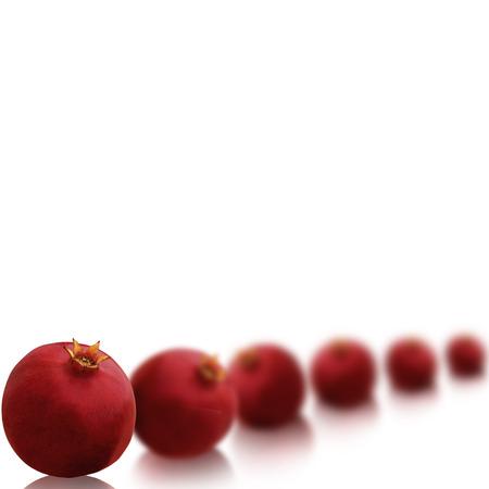 pomegranat: Bright red pomegranates isolated on white background with beautiful reflection Stock Photo