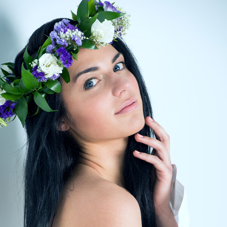supermodel: Beautiful woman supermodel wearing wreath of flowers close up portrait
