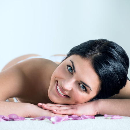 enhances: Pretty young brunette woman enjoying pampering that enhances her beauty Stock Photo