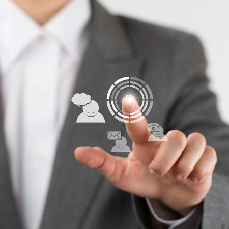 Business woman pointing her fingers on virtual web interface icons photo
