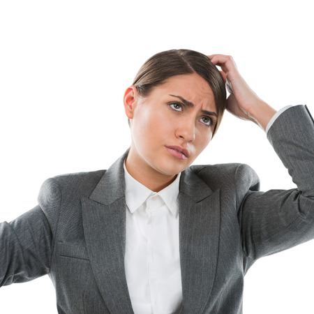 unawares: Portrait of confused female executive thinking on white background Stock Photo