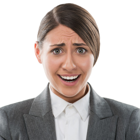 confused face: Portrait of shocked and confused business woman on white background Stock Photo
