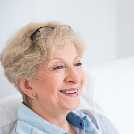 Senior woman portrait, at home with white hair