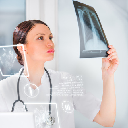 Medical doctor working with hologram interface at hospital photo