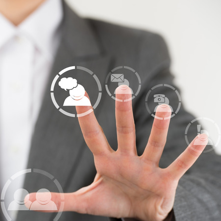 fingertip: Business woman pointing her fingers on virtual web interface icons