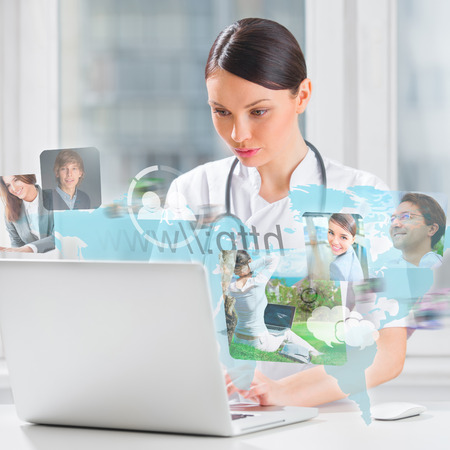 Female medical doctor surfing on web with modern laptop photo