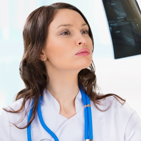 testicular: Female doctor looking at a testicles ultrasound results