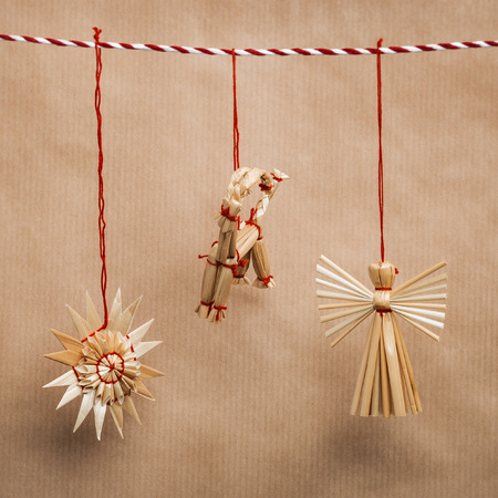 Handmade traditional christmas decoration angel, goat and snowflake from straw photo