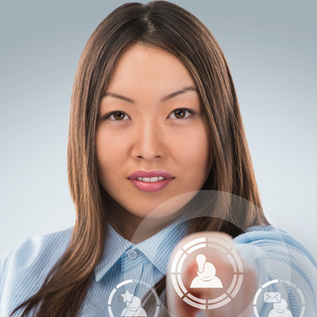 Asian business woman pressing social media icon photo