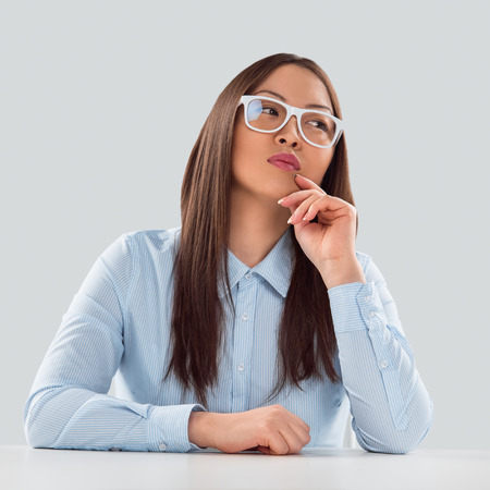 Sexy fashionable asian business woman sitting alone at office photo