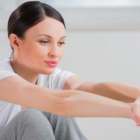 Woman stretching closeup portrait photo