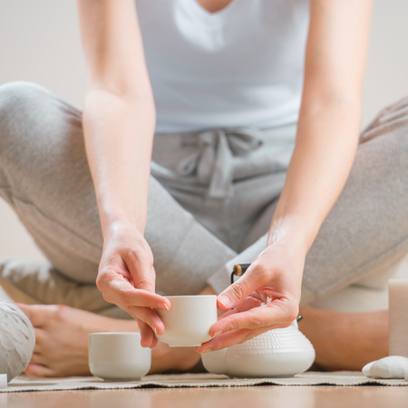 Young woman relaxing with tea and aromatherapy photo