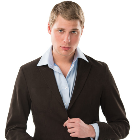 Portrait of a confident young male executive buttoning his cuff on white background Stock Photo - 27585139