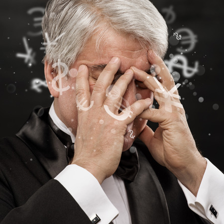 foundation problems: Bad Investment concept. Sad business man with currency symbols. Stock Photo