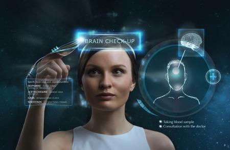 Female doctor doing checkup of human brain using futuristic computer technology Stock Photo