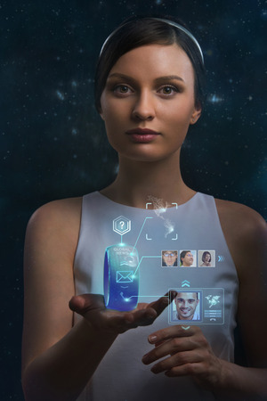 Woman holding wearable gadget. New technologies. Wireless tools. Future communications and social media concept. photo