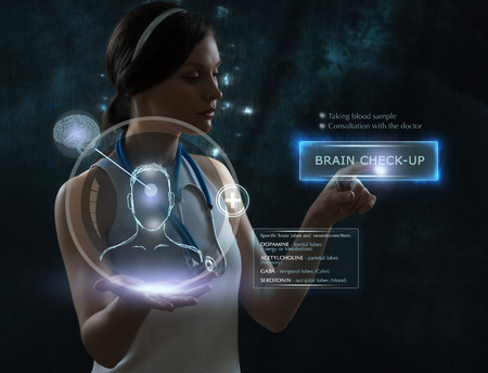 scanned: Female doctor doing checkup of human brain using futuristic computer technology Stock Photo