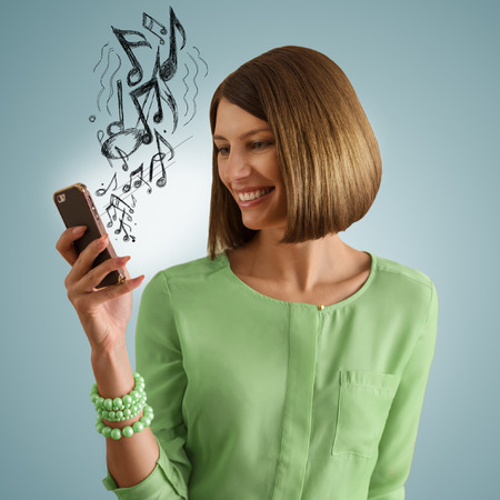 rnb: Woman listening to music using her smartphone