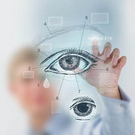 Male medical doctor working with virtual interface examining human eye Stock Photo