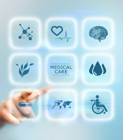 general insurance: Humans hand pushing the medical button. Medical care service concept Stock Photo