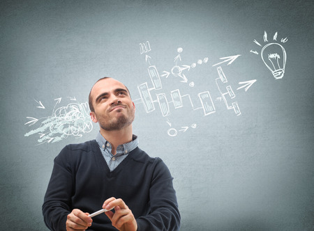 settling: Thinking businessman planning his business structure