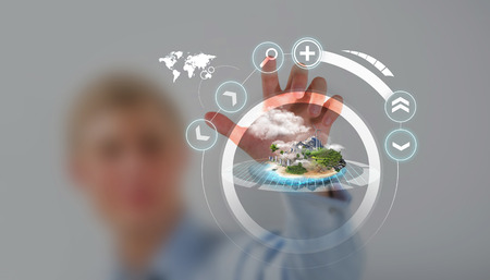 unrecognizable person: Unrecognizable person working with holographic city plan Stock Photo