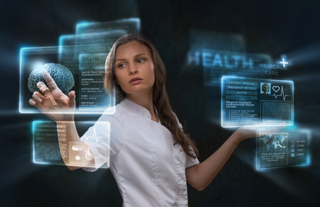 Female medical doctor working with virtual interface. Modern medical technologies concept photo