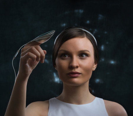 robot girl: People of the future. Pretty woman against cosmic background  Stock Photo
